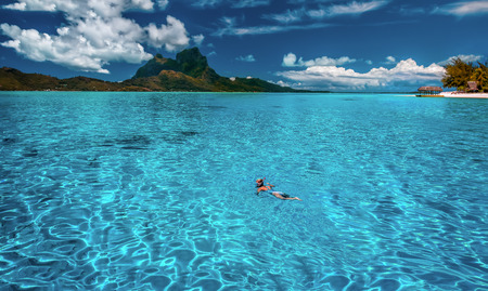 swimming in Tahiti lagoon 写真素材