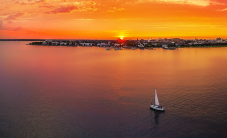 Charleston skyline with sunset and sailboat Stok Fotoğraf