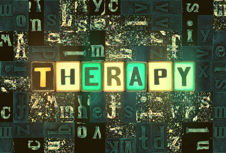 The word Therapy as neon glowing unique typeset symbols, luminous letters therapy