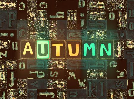 The word Autumn as neon glowing unique typeset symbols, luminous letters autumn