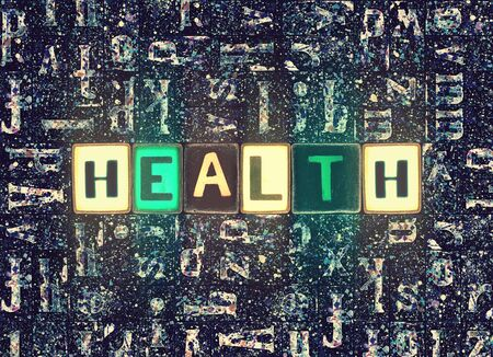 The word Health as neon glowing unique typeset symbols, luminous letters health Stok Fotoğraf