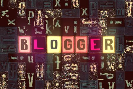 The word Blogger as neon glowing unique typeset symbols, luminous letters blogger Stock fotó