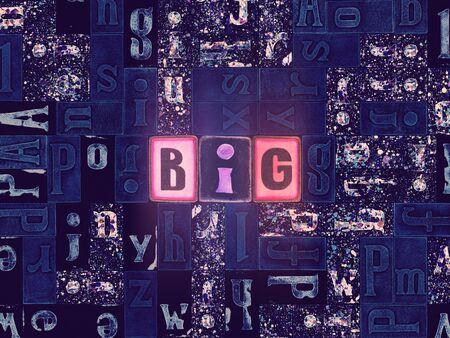 The word Big as neon glowing unique typeset symbols, luminous letters big Stok Fotoğraf