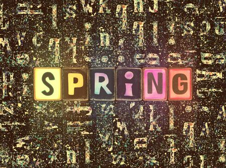 The word Spring as neon glowing unique typeset symbols, luminous letters spring Stok Fotoğraf