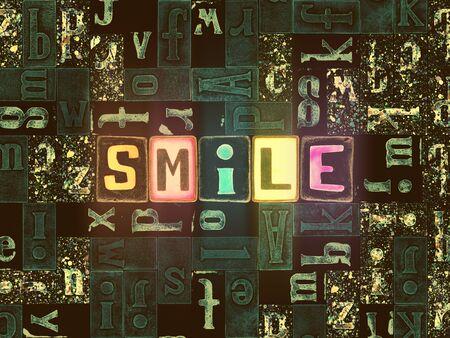 The word Smile as neon glowing unique typeset symbols, luminous letters smile Stok Fotoğraf