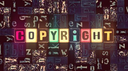 The word Copyright as neon glowing unique typeset symbols, luminous letters copyright