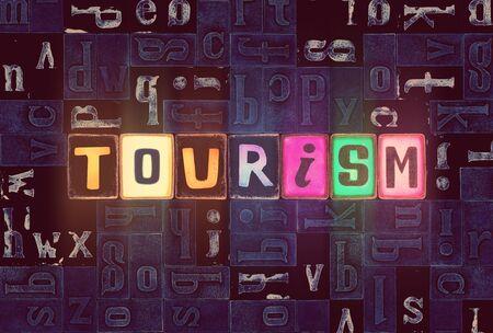 The word Tourism as neon glowing unique typeset symbols, luminous letters tourism Stok Fotoğraf