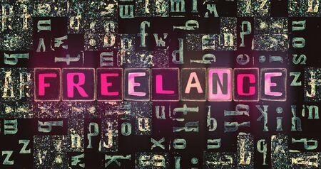 The word Freelance as neon glowing unique typeset symbols, luminous letters freelance Stok Fotoğraf