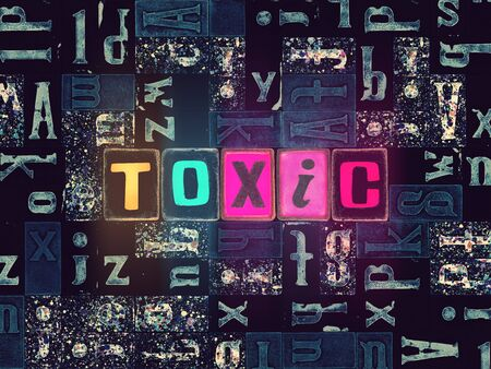 The word Toxic as neon glowing unique typeset symbols, luminous letters toxic