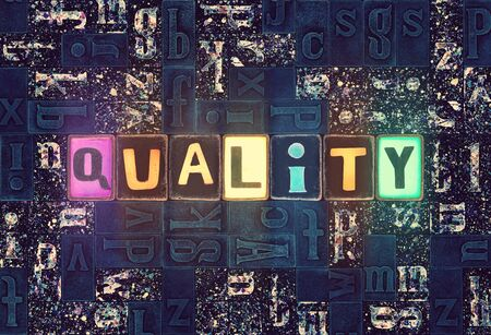 The word Quality as neon glowing unique typeset symbols, luminous letters quality
