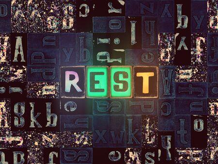 The word Rest as neon glowing unique typeset symbols, luminous letters rest Stok Fotoğraf