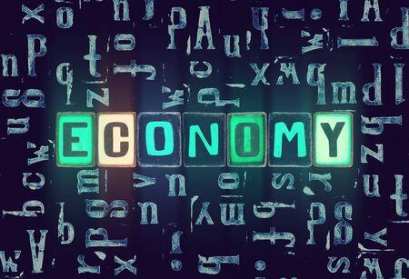 The word Economy as neon glowing unique typeset symbols, luminous letters economy Stok Fotoğraf