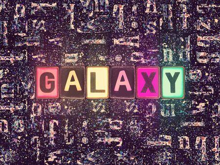 The word Galaxy with neon luminous glowing, unique typeset letters abstract mosaic pattern background, lettering symbols collection for galaxy poster
