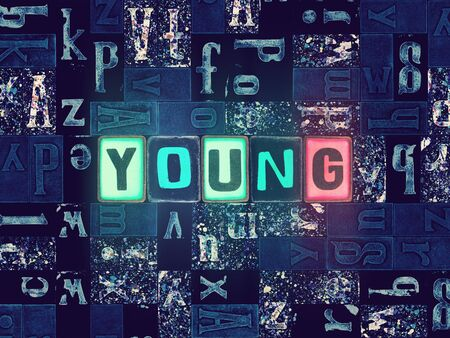 The word Young as neon glowing unique typeset symbols, luminous letters young Stok Fotoğraf