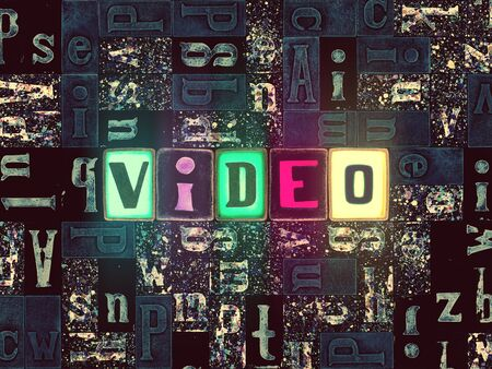 The word Video as neon glowing unique typeset symbols, luminous letters video