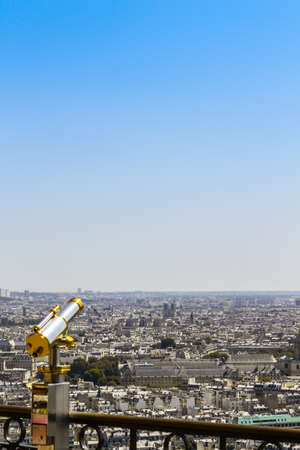 A telescope in a high place where you can look at the city of Paris
