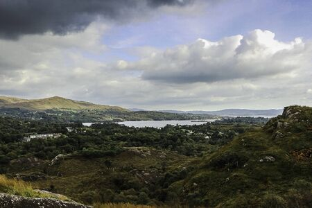 Beautiful landscape view of Bantry bay in Ireland, over Lady Bantrys overlook, with a cloudy sky