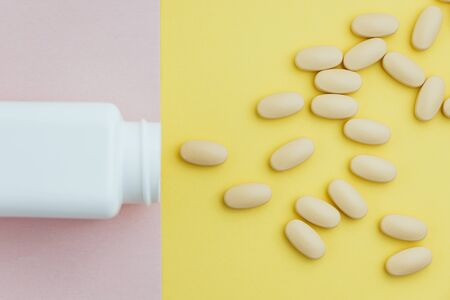 Overhead conceptual shot of pills running away from the bottle Reklamní fotografie