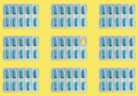 Flat lay seamless pattern of blister capsule packs on a yellow surface Reklamní fotografie