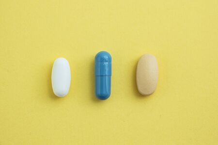 Three different medicine formats shot on a yellow background. Diversity concept