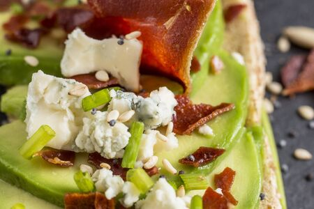 A extreme close up of a spanish delicious tapa with avocado Foto de archivo - 137823868