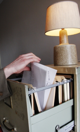 cloak and dagger: Searching through paperwork in a filing cabinet