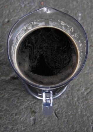 unwinding: A pitcher of dark beer