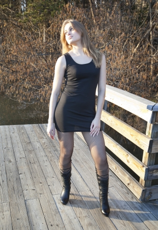 sassy: A sassy young woman posing on a dock