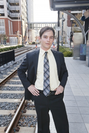 A young businessman waiting for a commuter train  photo