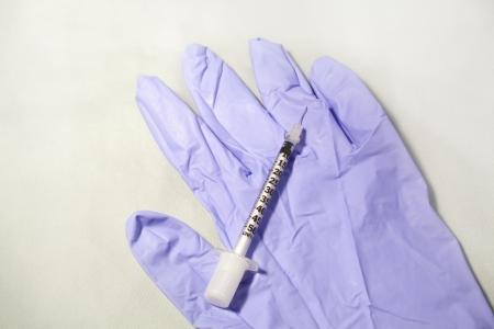 A needle on a blue glove