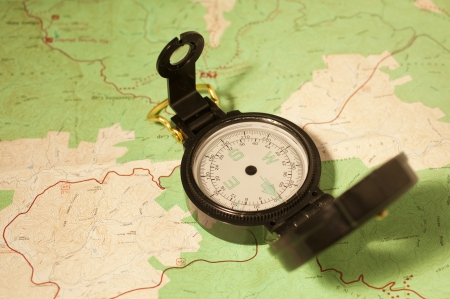 A lensatic compass  on a topographic map Stock Photo - 18651692