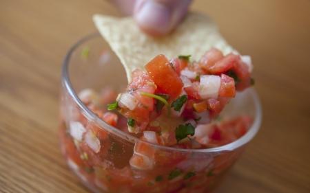 corn tortilla: A close up of a corn tortilla chip and salsa