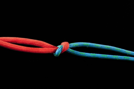 A square knot used to tie two paracords together Stock Photo