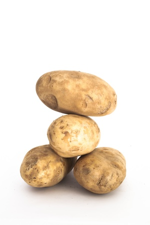 A stack of Russet Potatoes Stock Photo
