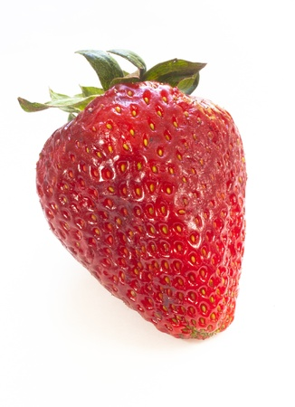 A closeup of a strawberry isolated against white Stock Photo