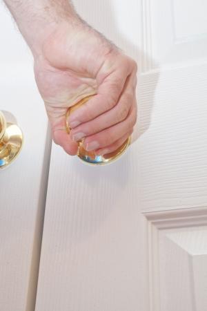 grasp: A hand grabbing a door knob