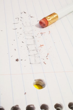 erased: The pencil written word failure erased on paper. Stock Photo