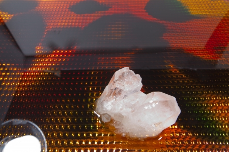 crystal background: A quartz crystal against a colorful background.