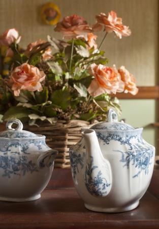 A antique tea set on a table photo