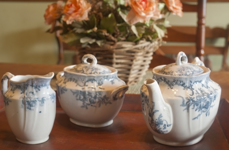 A antique tea set on a table