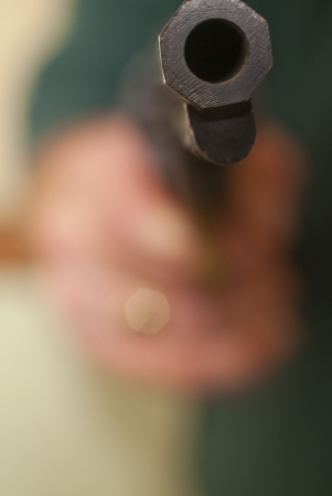 A man holding a gun photo