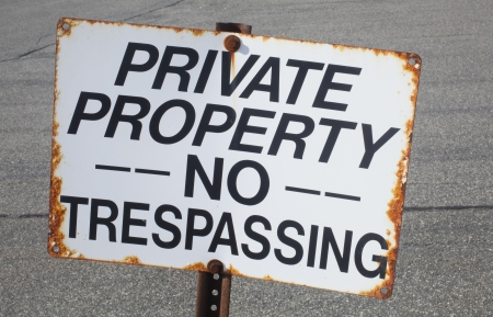 A Rusty No Trespassing Sign Stock Photo