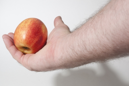 Handing out an apple Stock Photo