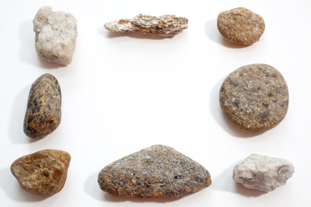 Stones arranged in a frame isolated against a white  Stock Photo
