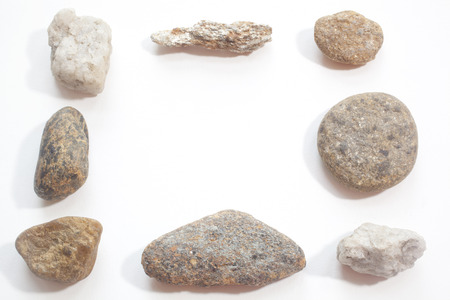 Stones arranged in a frame isolated against a white background Stock Photo - 25304012