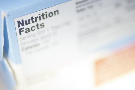 totals: Selective Focus on a Nutrition Facts Label.  Stock Photo