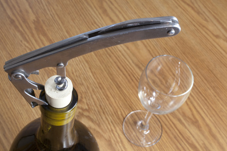 cork screw: Opening a bottle of wine with a cork screw