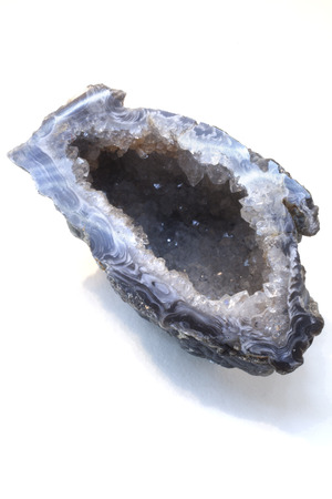A Quartz Geode isolated against a white bcakground Stock Photo - 25650576
