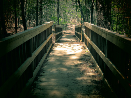 A filtered photo background of wooden footbridge.