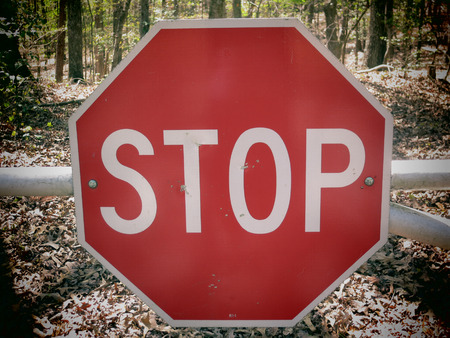 rural road: A filtered photo background of stop sign on a rural road.